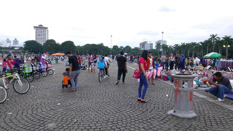 Weekend evening on Merdeka Square, area crowded by people, hawkers, beggars Footage