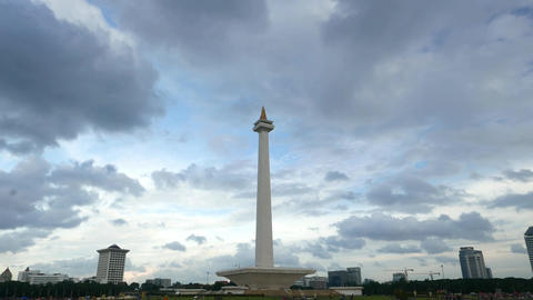 Dark clouds are gathering over the National Monument, Jakarta, long time-lapse Footage