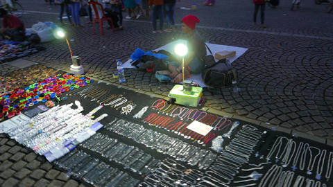 Man sell bijouterie on the cube pavement, parallax shot, Merdeka Square Footage