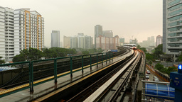Rapid KL train approaching station, pass by camera, urban city view Footage