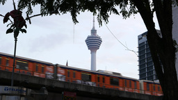 Elevated LRT line against KL Tower, train pass by to Masjid Jamek station Footage