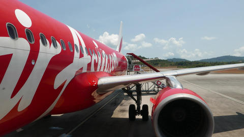 AirAsia plane livery, wing and engine view, FPV boarding by movable stairs Footage