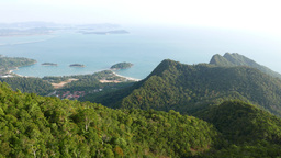 Tropical island rainforest mountains aerial sunny view, deep greenery Footage