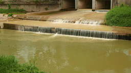Ecological problem, water pollution, open drainage stream falls into channel Footage