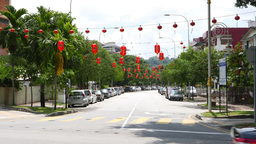 Green suburban street in sunny day, perspective, red chinese paper lanterns Live Action
