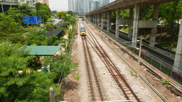 Suburban electric train move away, top outdoor view on railroad, green Footage