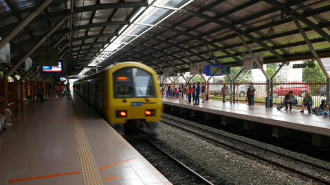 Electric train passing KTM Kommuter station without stop, people confused Footage