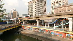 Elevated light railway transit line, canal, graffiti, bridge and Hotel Geo Footage