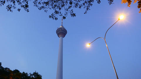 Beautiful evening close view KL Tower, dusk blue sky, pan shot Footage