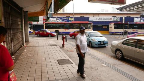 Walk on Jalan Hang Kasturi opposite to bus terminal under Pasar Seni LRT station Footage