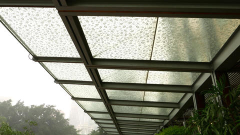 Raindrops on glass visor roof, ornate with leaf image. View from bottom on Footage