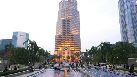 Menara Public Bank building, twilight, KLCC, panning down to fountain Footage