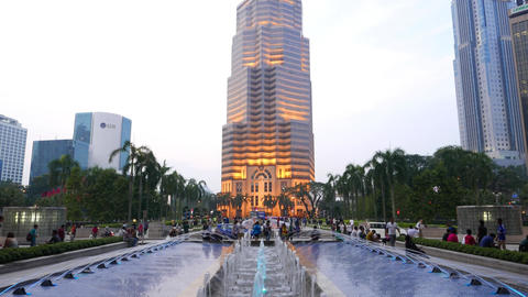 Menara Public Bank building, twilight, KLCC, panning up from fountain view Footage