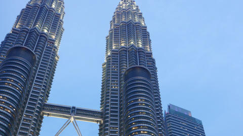 Skybridge between Petronas Twin Towers in dusk, close view, panning shot Footage