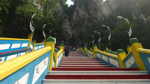Move up steep staircase to Batu Caves entrance, empty area, few people Footage