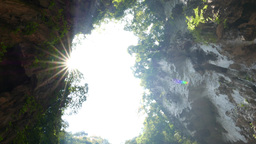 Sky window from cave floor, sunlight shine brightly, turning around Footage