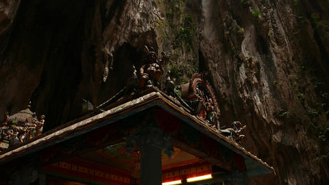Hindu shrine in Batu Caves panning to roof decoration sculptures Footage