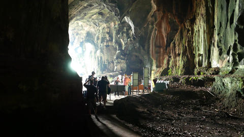 Group of tourist came out from dark cavern, end of excursion in Dark Cave Live Action