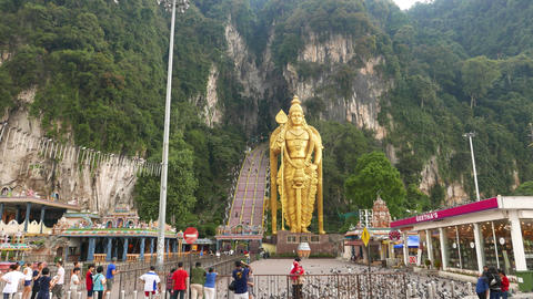 Tall golden statue and huge staircase rising up to the mountain cave, foresty Footage