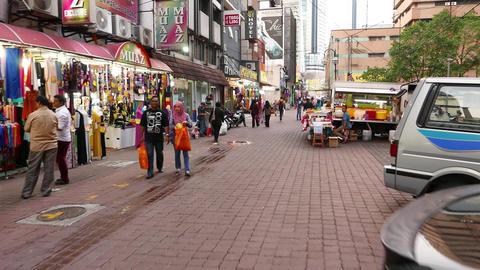 Walk on street, shops, people on the way, motorbike, garments store Footage
