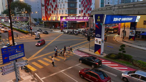People crossing evening street junction top view Footage