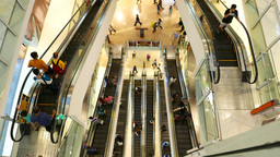 Multilevel escalators view from top, modern mall atrium, people travelling Footage