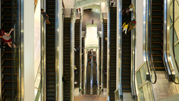 Parallel moving escalators on different levels, straight top view Footage