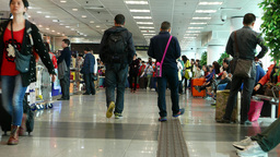 China ferry terminal interior, duty free zone, passengers walking and waiting Footage