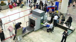 Passengers put bags and suitcases on security scanner tape, top view Footage