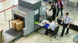 X-Ray scanner in airport, security inspection for passenger luggage Live Action