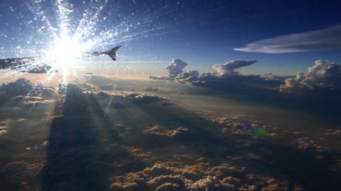 Amazing view from airplane window clouds shadows and sunset Footage