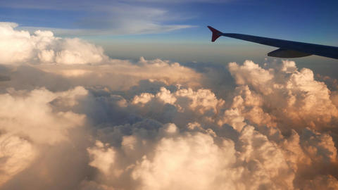 Beautiful cumulus clouds view from aircraft window, timelapse Footage
