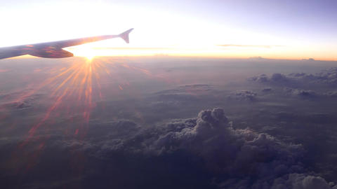 Dark cloudscape and bright sunset rays, amazing nature view from aircraft Footage