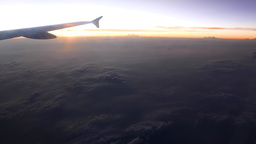 Flying at evening time, afterglow view, voice announcement in the aircraft Footage