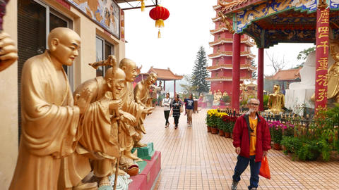 Gold Buddhas statues around building, Main Plaza and pagoda at temple Footage