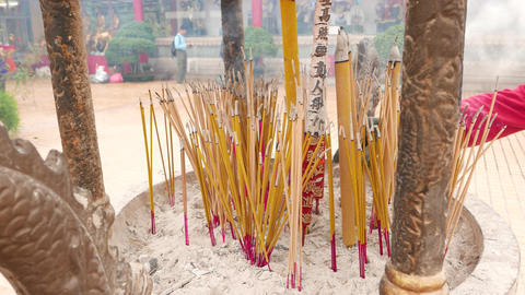 Many incense sticks, much smoulder with smoke in courtyard of the temple Footage