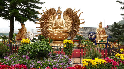 Thousand hands golden Buddha sculpture in Buddhist temple Footage
