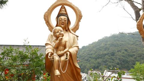 Baby Buddha statue in the Ten Thousand Buddhas Monastery Footage