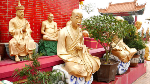 Sitting Golden Buddha statues at pagoda basement, Ten Thousand Buddhas Monastery Footage