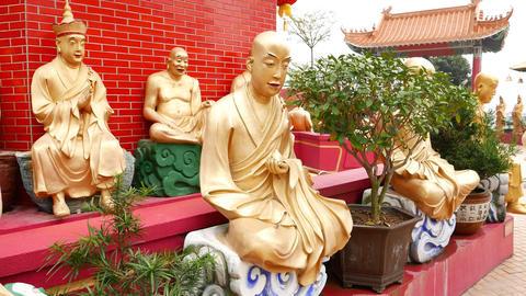 Sitting Golden Buddha statues at pagoda basement, Ten Thousand Buddhas Monastery Live Action