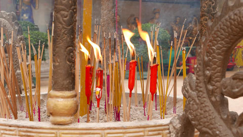Red, orange burning and smouldering incense stick, close up view Footage