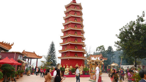 Beautiful red pagoda in gorgeous monastery courtyard, Chinese new year Footage