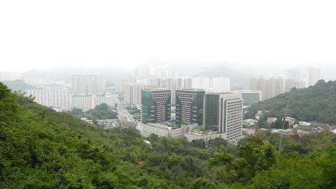 Foggy chinese city view from mountain side, buildings and pagoda Footage