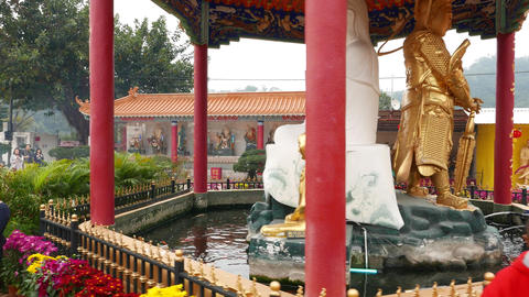 Chinese pavilion with white Buddha statue, courtyard of Ten Thousand Buddhas Footage