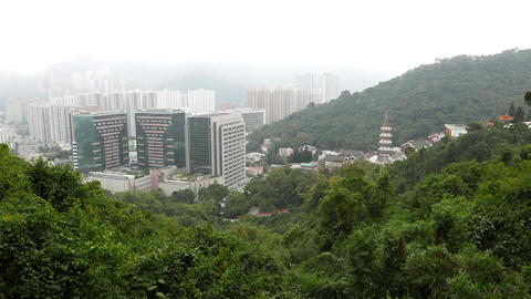 City view from mirador on mountainside, woodland slopes and buildings Footage