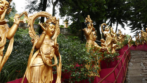 Stairs leading up, decorated with gold Buddha statues on both sides Footage