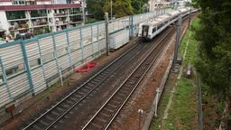 Passenger train leaving afar, top perspective railways view Footage