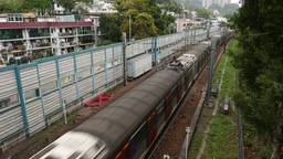 MTR train quickly moves from afar, overground part of the line Footage
