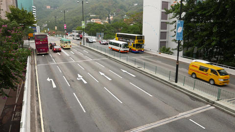 Left-hand drive viaduct road, view from above point, buses and cars Footage