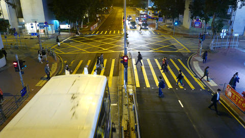People walking on pedestrian crossing, bus stops before zebra, top view Footage